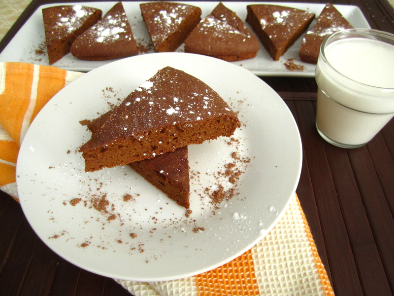 Brownie slices on plate with glass of milk